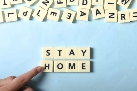 Boy hand completing STAY HOME puzzle Stock Photo