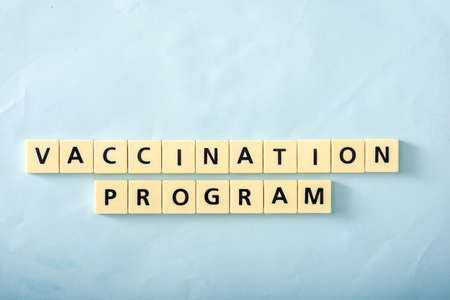 Vaccination program word on blue background