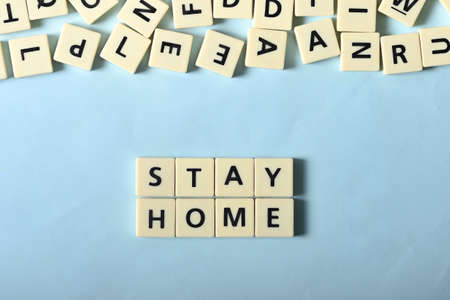 Stay home on plastic block Stock Photo