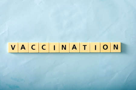 Vaccination word on blue background