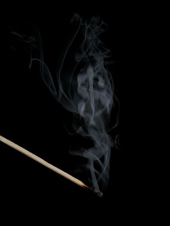 Dollar sign appears in smoke photo