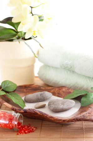 Yellow orchid, massage stones, two towels isolated on white background Stock Photo - 5098072