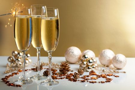 three glasses of champagne, christmas balls and ornaments in front of golden background Stock Photo - 5445733