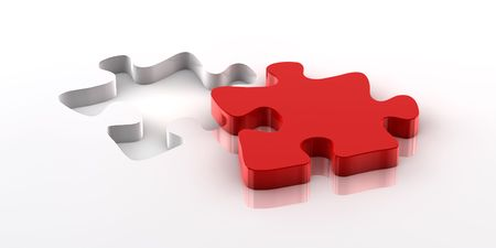 fitting in: A red piece of a jigsaw puzzle fitting in the hole on the bottom Stock Photo