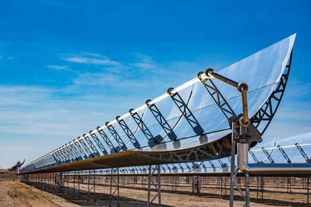 Solar cells or solar module or solar panels in solar power plant turn up skyward absorb the sunlight from the sun use light energy to generate electricity on blue sky