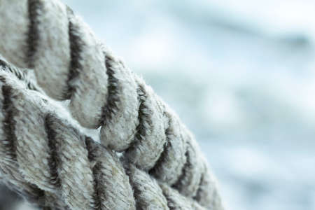 Shipping  Close up with clean ropes in foreground and water in background  photo