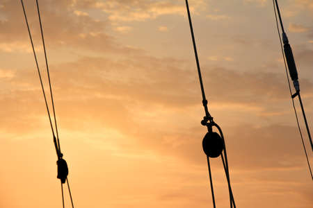 let s: Afterglow with rope silhouettes  Romantic shipping scene  Let s go for an adventure trip