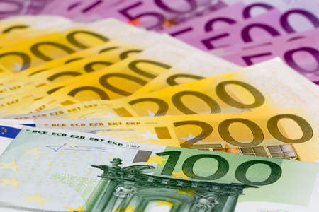 bail: Macro stack of money with 100 200 and 500 euro banknotes  Perfect for illustrating e g  wealth, lottery prizes or banking crises  What is your dream