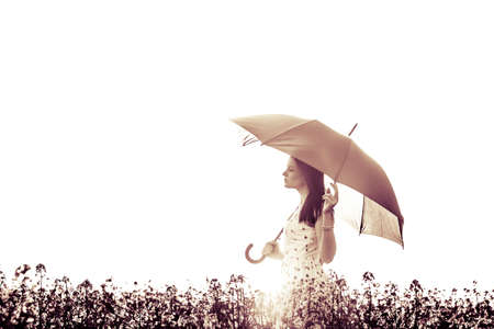 woman in dress: Beautiful eyes closed art woman with umbrella in meadow. The picture is digitally altered for at artificial style