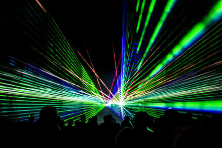 Laser show rays stream. Very colorful show with a crowd silhouette and great laser rays on pyrotechnic festival in germany.