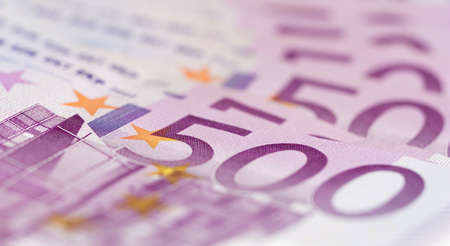 Close up from stack of money with 500 euro banknotes. Perfect for illustrating e.g. wealth, lottery prizes or banking crises. What is your dream. Stock Photo