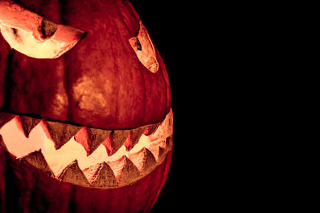 diabolic: Side view halloween pumpkin smile with fire burning eyes mouth. Big spooky helloween symbol has a glowing mad face and smiling with sharp teeth and bad look. Black orange nightmare of October 31st.