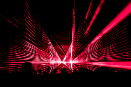 Red laser show nightlife club stage with party people crowd. Archivio Fotografico