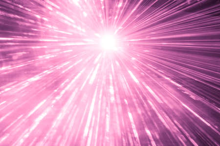 Pink laser show rays at top nightlife party event performance. Luxury entertainment with bright light source and many beams and streams to every side at nightclub event, festival or New Years Eve. 写真素材