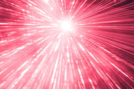 Red laser show rays at top nightlife party event performance. Luxury entertainment with bright light source and many beams and streams to every side at nightclub event, festival or New Years Eve.