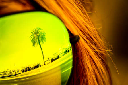 Vintage tropical luxury paradise beach palm glasses reflection. Exciting mirror imaging at sunglasses on head. Beautiful symbol of tourism vacation trip travelling to holiday dream island. Copypace.