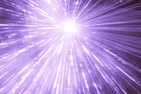 Purple laser show rays at top nightlife party event performance. Luxury entertainment with bright light source and many beams and streams to every side at nightclub event, festival or New Years Eve.