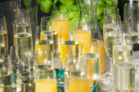 Luxury welcome drink champagne at gala party success celebration. Mixed glasses with orange juice to celebrate launch event wedding, business meeting or anniversary by restaurant catering service.