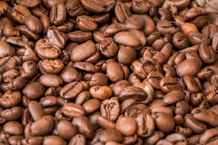 Bunch of tasty delicious roasted coffee beans in coffeeshop. Fresh gourmet flavor aroma. Luxury enjoyment aroma in the morning. Fair trade cafe cappuccino or espresso ingredient for breakfast.