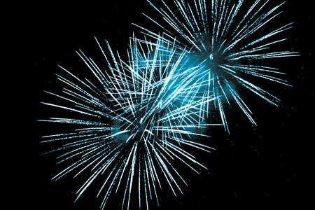 Luxury fireworks event sky show with blue big bang stars. Premium entertainment magic star firework at e.g. New Years Eve or Independence Day party celebration. Black background copyspace.