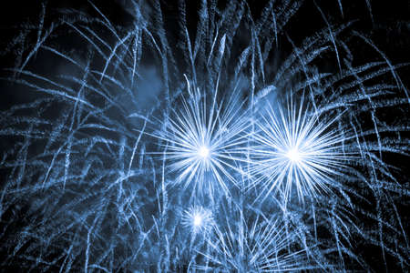 Luxury fireworks event sky show with blue big bang stars. Premium entertainment magic star firework at e.g. New Years Eve or Independence Day party celebration. Black dark night background. Stock fotó