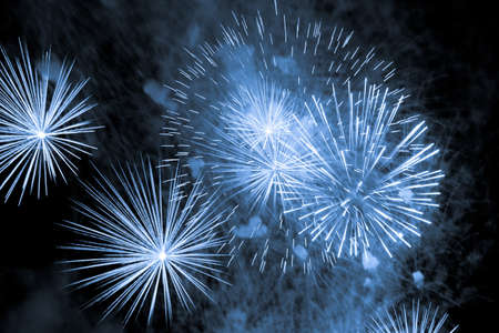 Luxury fireworks event sky show with blue big bang stars. Premium entertainment magic star firework at eg New Years Eve or Independence Day party celebration. Black dark night background. Banco de Imagens