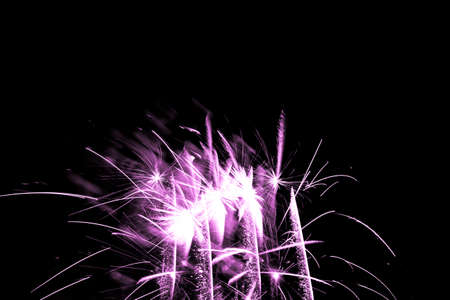 Luxury fireworks event sky show with pink glow stars. Premium entertainment magic star firework at eg New Years Eve or Independence Day party celebration. Black dark night background.