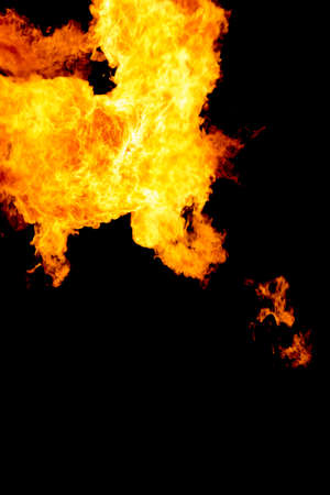 Dangerous orange yellow flashing fire flames on black background. Burning hot flame with energy in motion. Industry power and heat from pellet oil gas fuel or wood. Danger through ignition explosion.