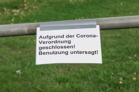 Corona virus quarantine lockdown prohibit entry community area. Covid-19 safety prevention. Closure prohibition sign. German text mean closed because of coronavirus restriction regulation! Keep off! 免版税图像