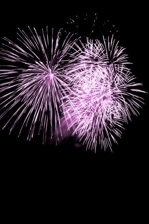Luxury fireworks event sky show with pink big bang stars. Premium entertainment magic star firework at eg New Years Eve or Independence Day party celebration. Black dark night background. Stock fotó