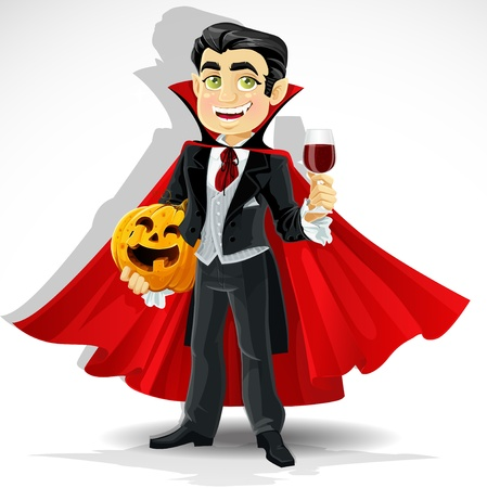 Charming predatory vampire with Halloween pumpkin and a glass of blood