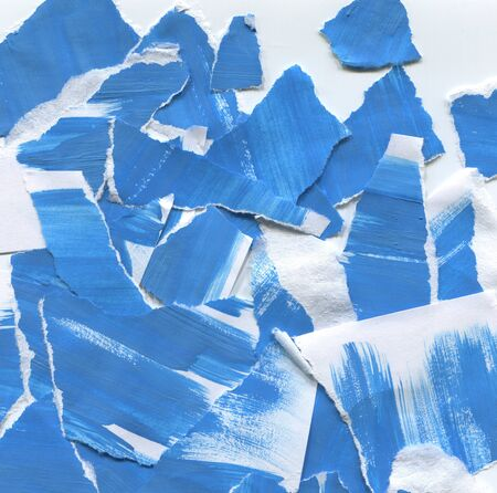 Abstract background of painted and torn blue paper photo