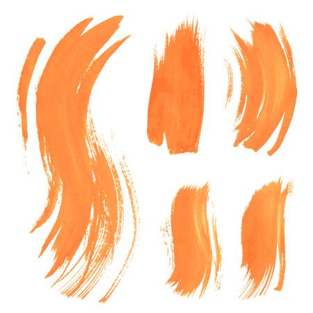 Stel textuur oranje verf uitstrijkjes op een witte achtergrond