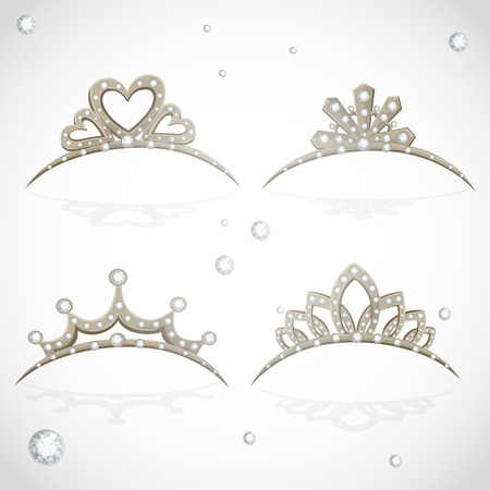 Shining gold tiaras with diamonds isolated on a white background