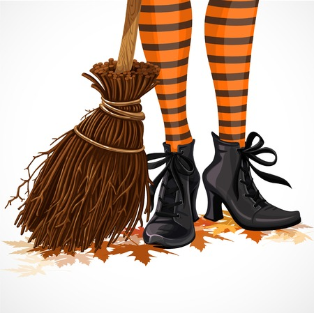 Halloween closeup witch legs in boots and with broomstick standing on fallen leaves isolated on a white background Vectores
