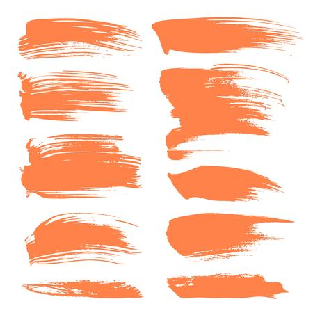 brush stroke: Abstract spots of orange paint isolated on a white background
