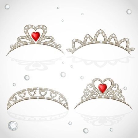 object complement: Openwork jewelry tiaras with diamonds and faceted red stones in a heart shape isolated on white background