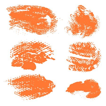 dry brush: Textured dry brush strokes of orange paint on white background