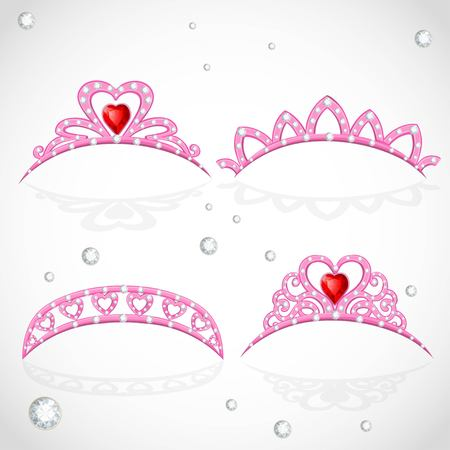 object complement: Pink tiaras with diamonds and faceted red stones in a heart shape isolated on white background