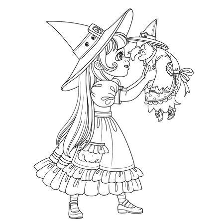 人形の古い魔女輪郭を描かれた着色のページを保持している魔女の衣装でかわいい女の子