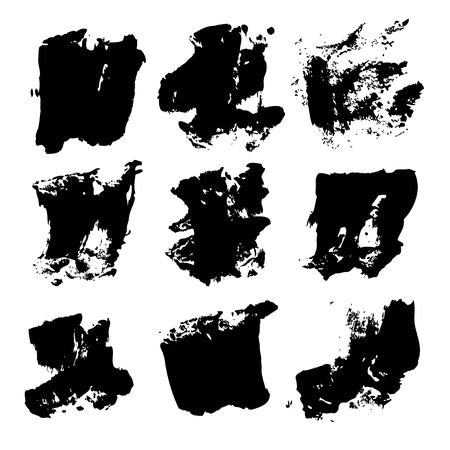 wet paint: Abstract big black textured brush strokes isolated on a white background.