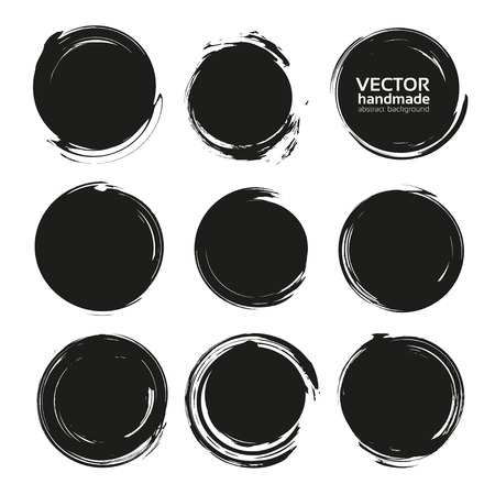 Black abstract textured solid circle smears isolated on a white background