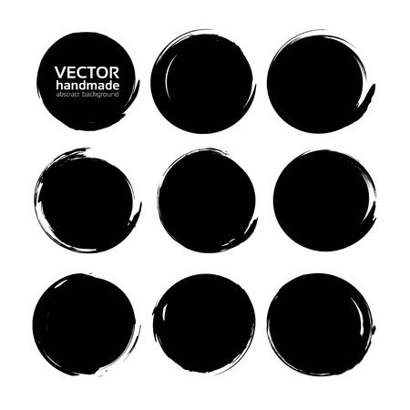 Black round textured smears set isolated on a white background