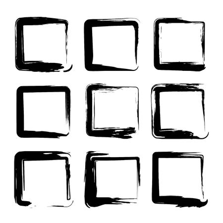 Square smears of black textured brush strokes isolated on a white background