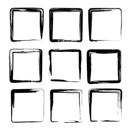 Square smears of black ink textured brush strokes isolated on a white background
