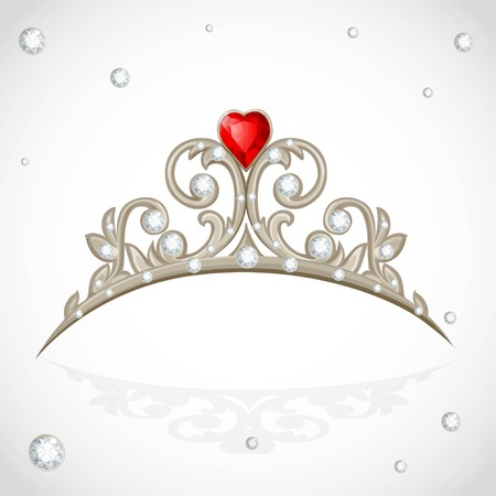 Golden jewelry tiara with diamonds and faceted red stone in a heart shape on white background