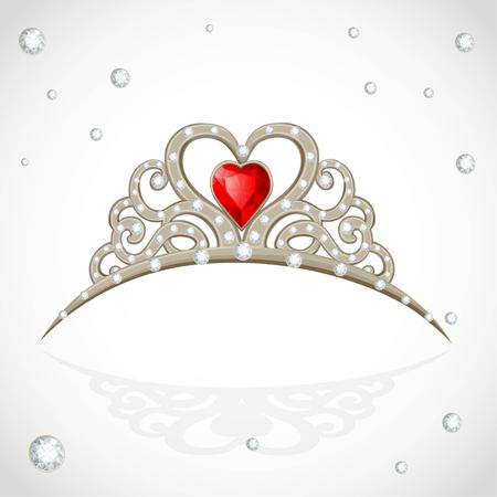 Golden jewelry tiara with diamonds and faceted red stone on white background