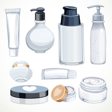 Set of cosmetics objects white jars and transparent bottles with cream or liquid isolated on a white background Foto de archivo - 124633198