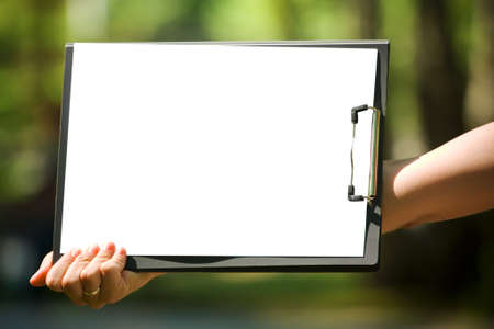 The clipboard with the white sheet of paper photo
