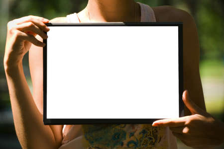 The white sheet of paper on the clipboard in hands photo